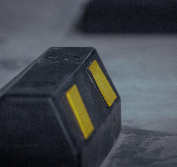 neoland-tope-topellanta-topellantas-caucho-llanta-cinta-reflectiva-caucho-reciclado-llanta-portafolio-producto-parqueadero-vial-empresa-bogota-colombia-foto